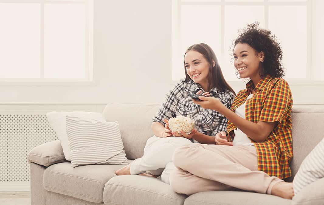 Roommate girls enjoying movie night